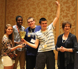 The team from duPont Manual High School of Louisville, Ky., composed of Shea Dobson, Kinsey Ball, Jack Grossman and Joshua Svoboda, celebrates after winning the National Journalism Quiz Bowl at the JEA/NSPA spring convention in San Diego April 12, 2014. Quiz Bowl committee member Marilyn Chapman, CJE, of Florence, S.C., (far right) presented the trophy to the team. Photo by Kay Windsor.